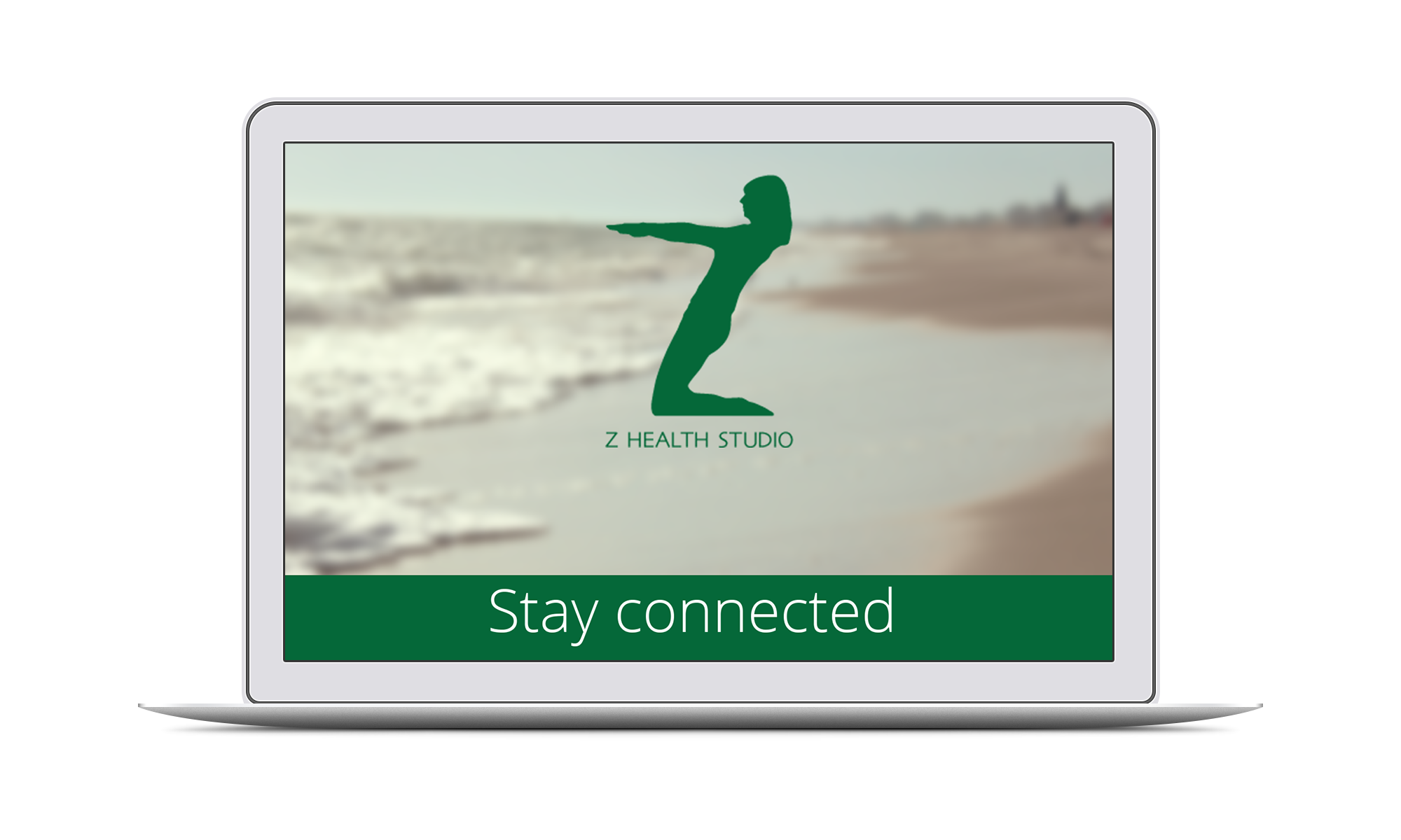 Laptop with Z Health Studio newsletter and Paraparaumu Beach in the background